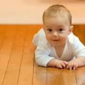 Baby crawling across lovely warm underfloor heated floor